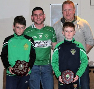 Aughlisnafin U12.5 championship winning team joint captains Rhys Clarke and Marc Quinn with managers Ciaran Rice and Wayne Pickering